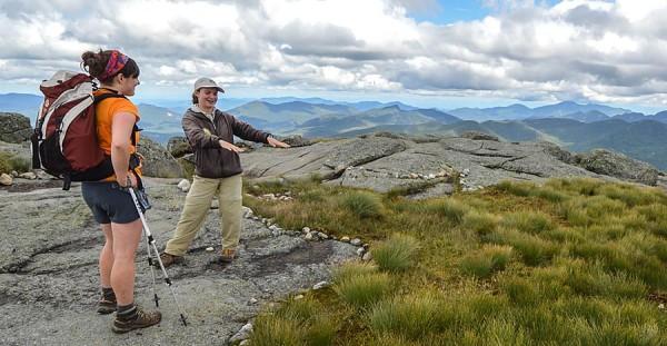 Northeast alpine steward with hiker